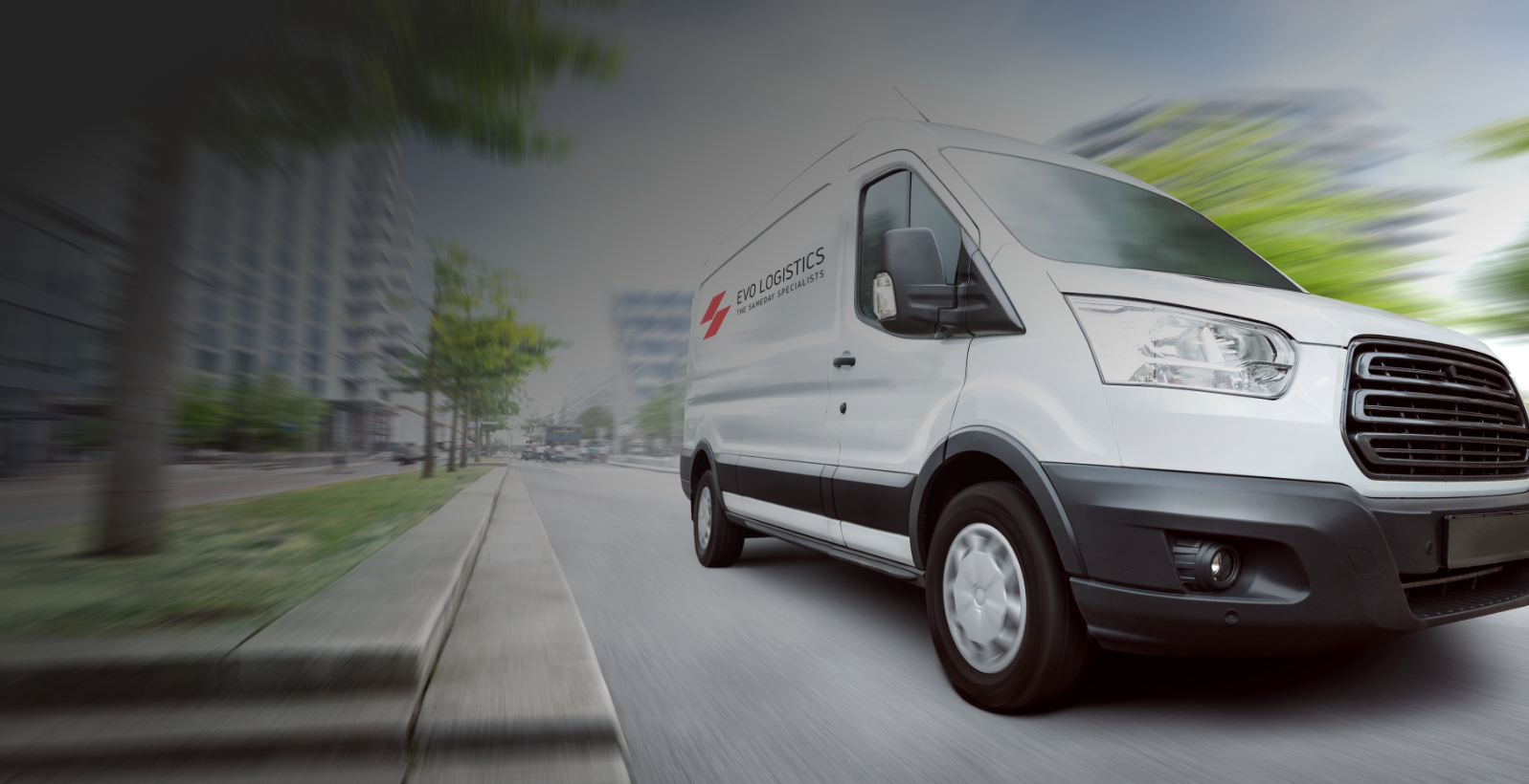 White Evo Logistics mini truck driving on the road